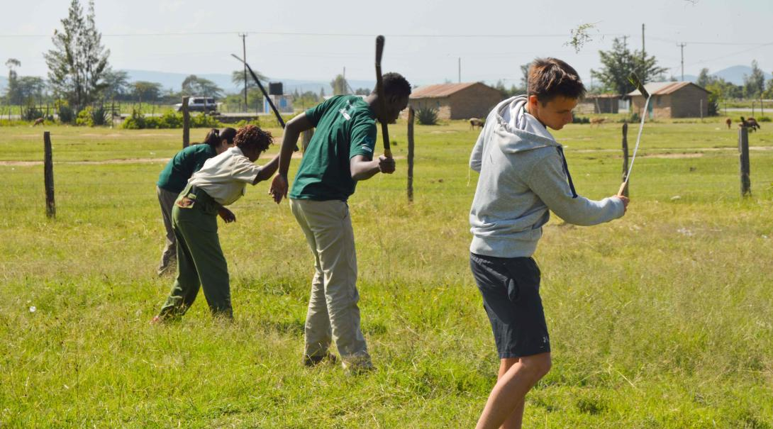 Projects Abroad conservation volunteers help remove invasive plant species in Kenya during their Giraffe and Lion conservation project.